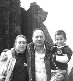 Doug Rhodes with wife, Ana Maria, and their grandson, below the 'Yogi Bear' rock formation