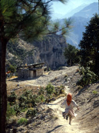 Young Tarahumara girl runs to mountain side school on The California Native Copper Canyon Tours