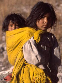 In Mexico's Copper Canyon, a Tarahumara girl carries her baby sister on her back.