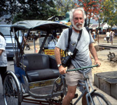 Soaking wet California Native founder, Lee Klein, pedals his rickshaw back into the melee of Songkran's Water Festival.
