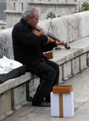 Street violinist in Budapest, Hungary.