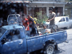 During Songkran, the Southeast Asian New Year, people cruise the street in pickup trucks loaded with kids throwing water.