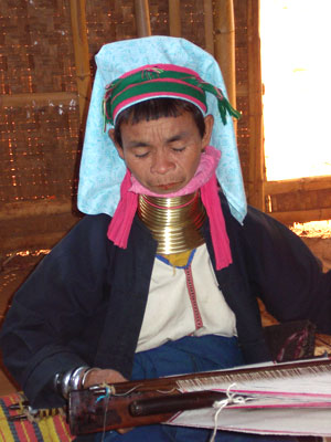 In Myanmar (Burma), a tribal lady weaves cloth.