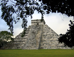 Mayan Pyramid shaded by jungle growth on The California Native Yucatan Tours