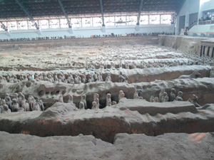 Side view of the Terracotta Army in one of the pits still being excavated.