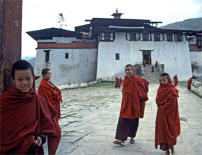A group of young monks greet visitors at a monastery in Bhutan.
