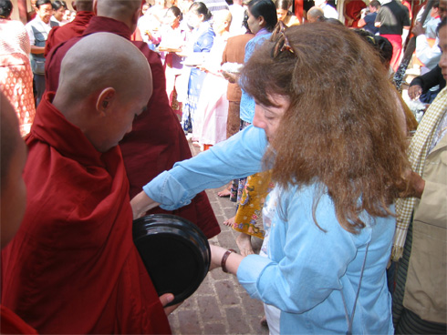 California Native, Ellen Klein, serving rice to monks in Myanmar.