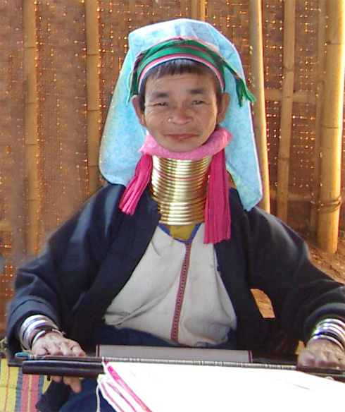 A lady of the Long Neck Padaung tribe displays the neck rings she has worn since her youth.