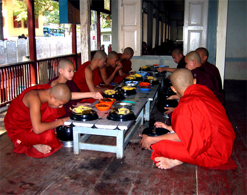 Young monks in Myanmar taking their daily meal