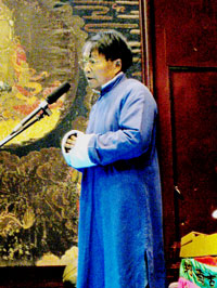 Naxi Orchestra conductor Xuan Ke addresses the audience in the city of Lijiang, China.