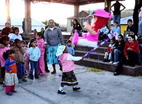 Tarahumara children celebrate Christmas with a piñata at Copper Canyon's Paraiso del Oso.
