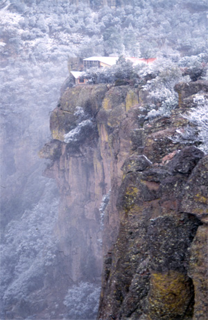 A light snow paints Mexico&#039;s Copper Canyon in holiday colors.