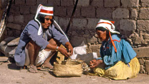In Mexico's Copper Canyon, a Tarahumara man helps his wife with her chores.