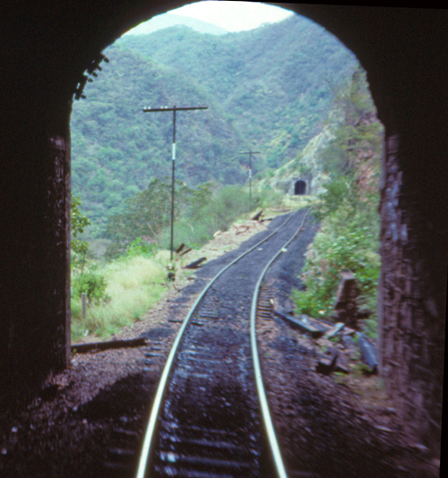El Chepe train exiting one of the 86 tunnels it will pass through on it's way through Copper Canyon.
