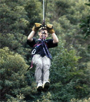 California Native zip lining over the canopy in a Costa Rican rainforest.