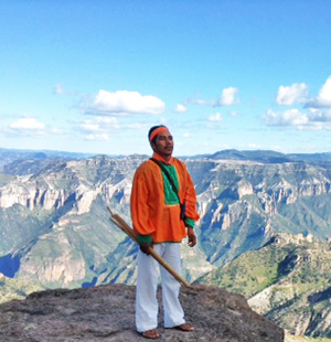Tarahumara indian at one of the many beautiful Copper Canyon view points.