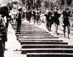 Prisoners build Bridge on the River Kwai.