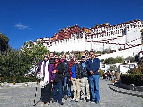 California Native's Lee & Ellen Klein in a group standing in front of the Potala Palace.