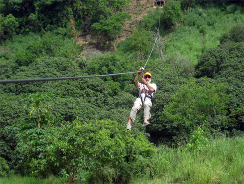 California Native founder Lee Klein on zip-line over rain forest in Veracruz, Mexico