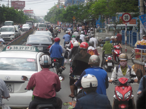Traffic in Vietnam is a mad melange of motorbikes and cars.