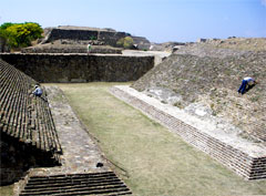 Workers work on restoration of a Mayan ballfield.